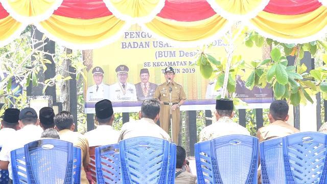 Bupati HM Wardan Kukuhkan BUMDes se Kecamatan Mandah di Pantai Solop